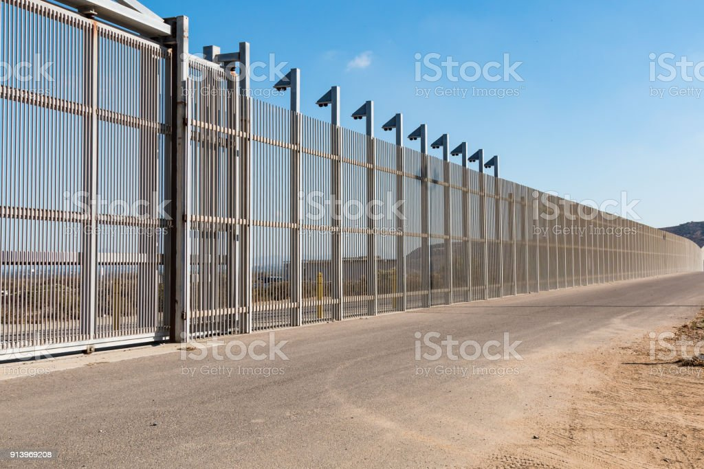 Section of Inner International Border Wall Separating San Diego and Tijuana stock photo