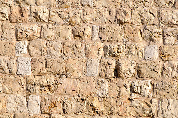 Ottoman-era stone wall surrounding the Old City of Jerusalem Section of the Ottoman-era stone wall that surrounds the Old City of Jerusalem jerusalem old city stock pictures, royalty-free photos & images