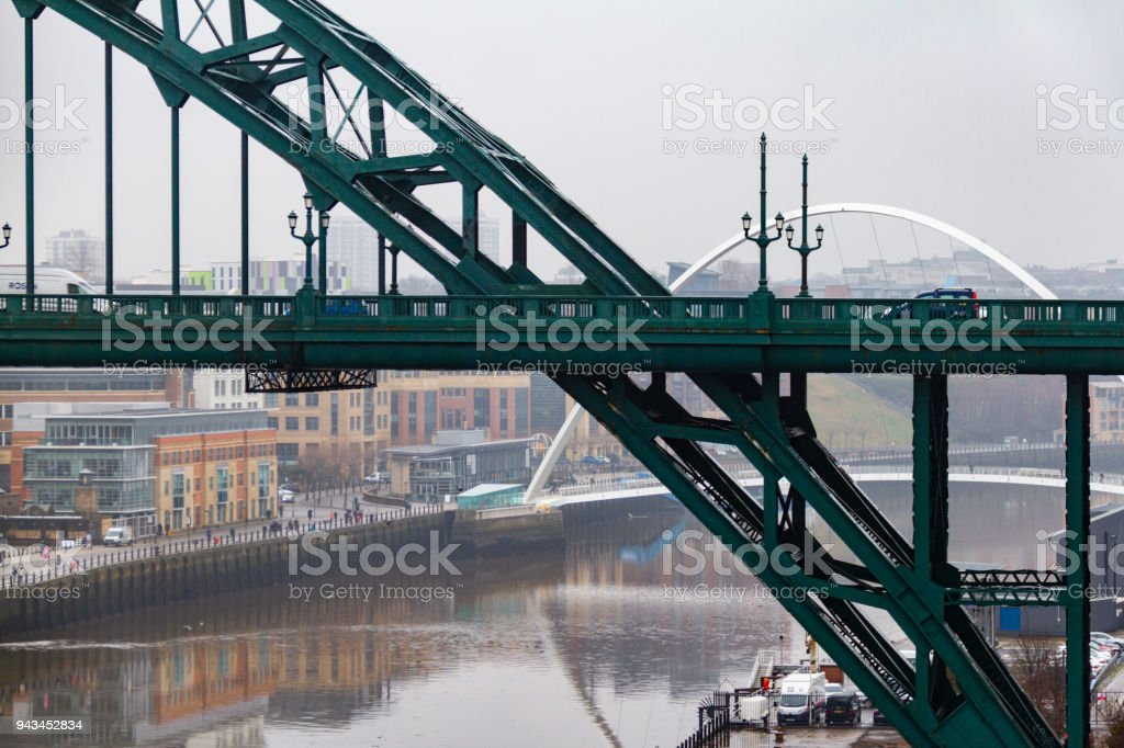 Section of the Tyne Bridge in the foreground and Millenium Bridge in the distance at Newcastle Quayside stock photo