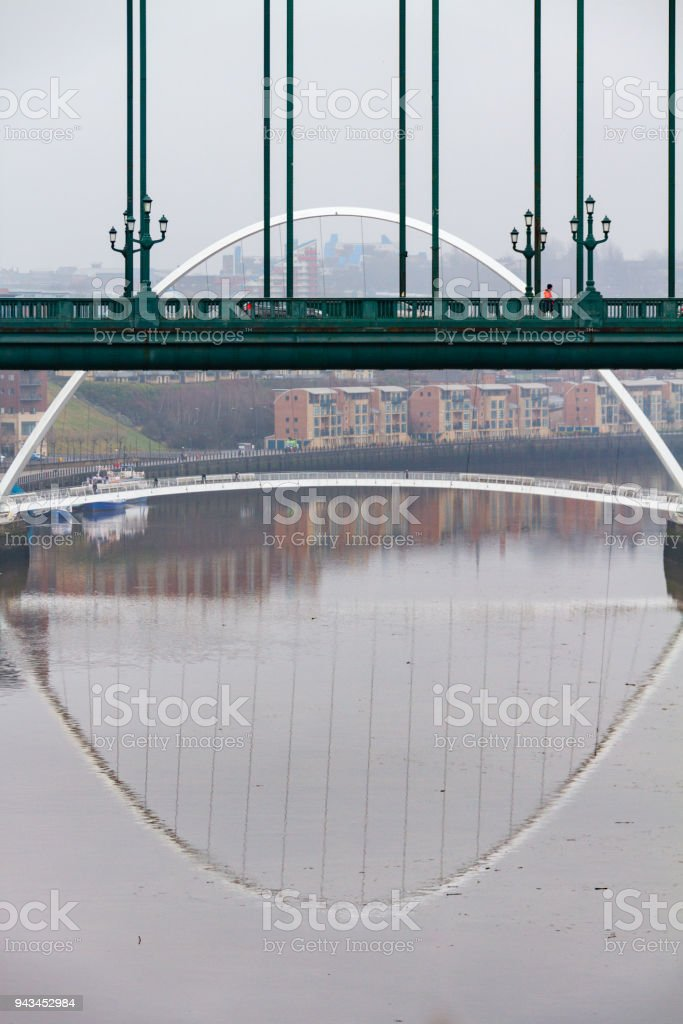 Section of the Tyne Bridge in the foreground and Millenium Bridge in the distance at Newcastle Quayside in portrait stock photo