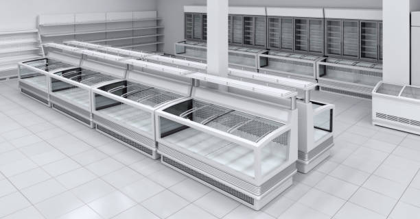 Section with refrigeration showcases in the supermarket. stock photo