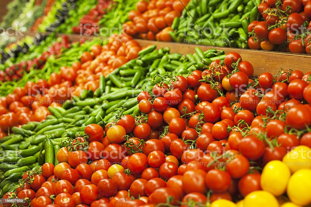 Sections of fresh organic vegetables in a market stall stock photo