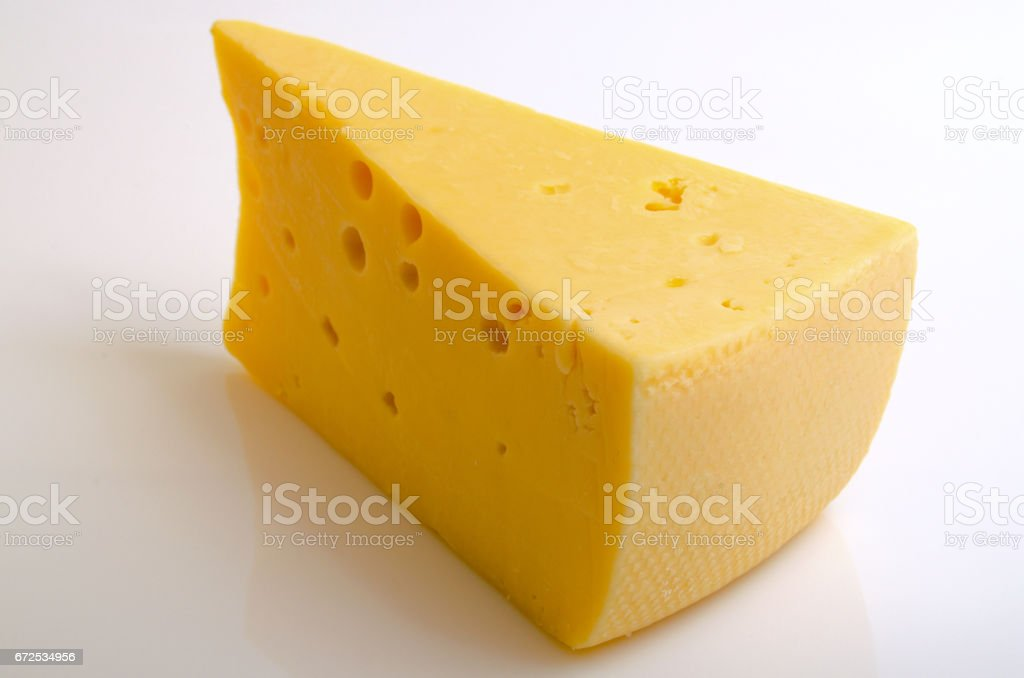 Sector of hard cheese. stock photo