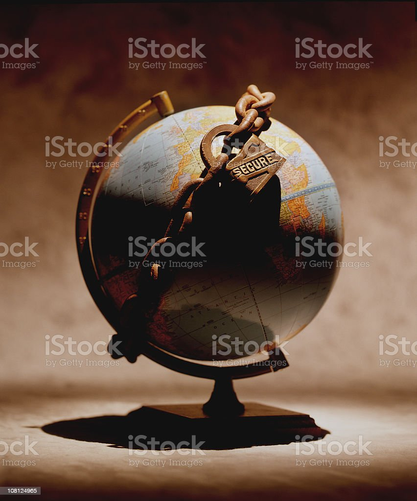 Secure Lock and Chain Wrapped Around Globe royalty-free stock photo