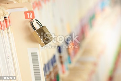 Secure and protected medical records. Bar code added to folder, not actual patient information. Concept image. Narrow depth of field.
