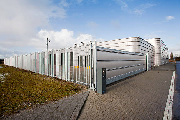 Secure metal industrial building Well secured metal industrial building security equipment stock pictures, royalty-free photos & images
