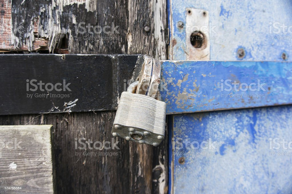 Secure padlock on a building royalty-free stock photo