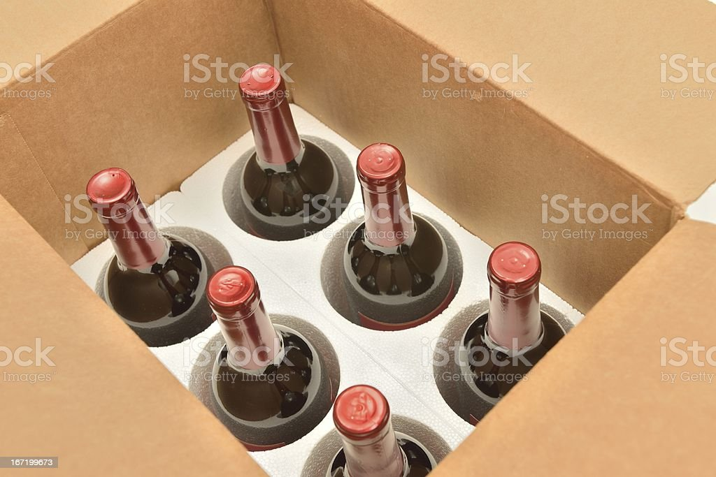 Secure shipping of wine bottles in a box stock photo