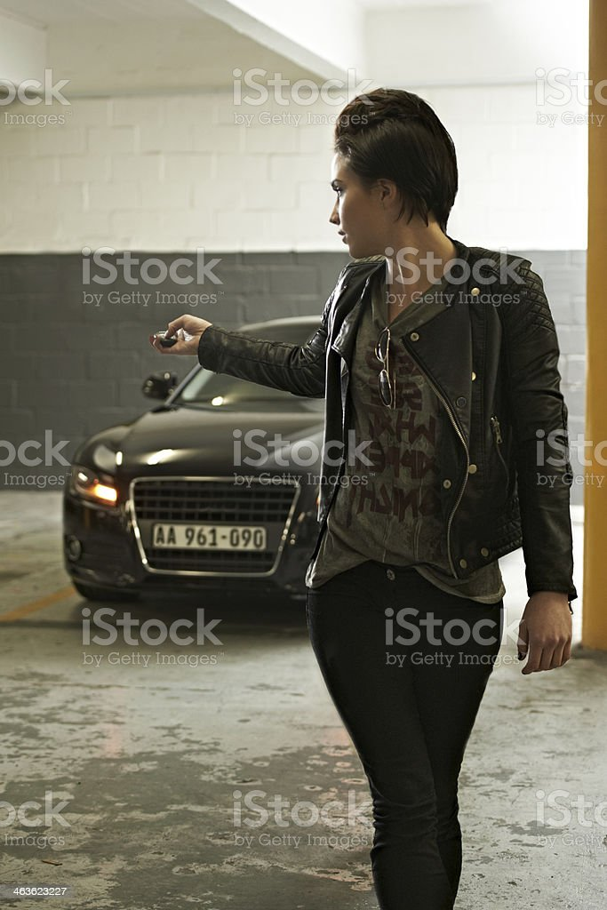 Securing her sedan stock photo