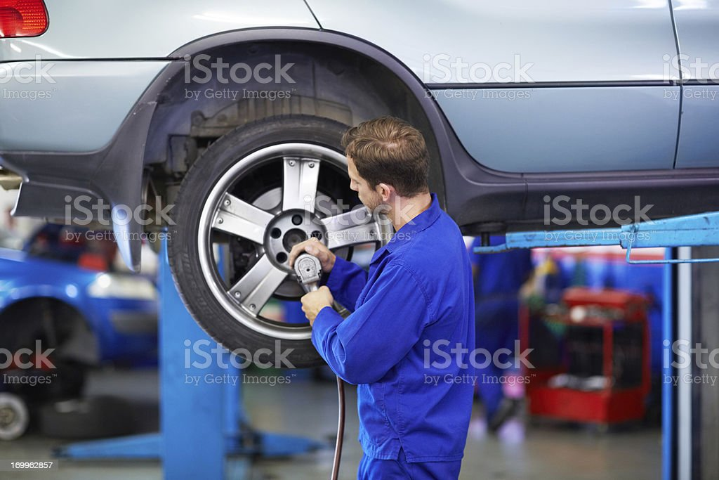Securing the wheel royalty-free stock photo