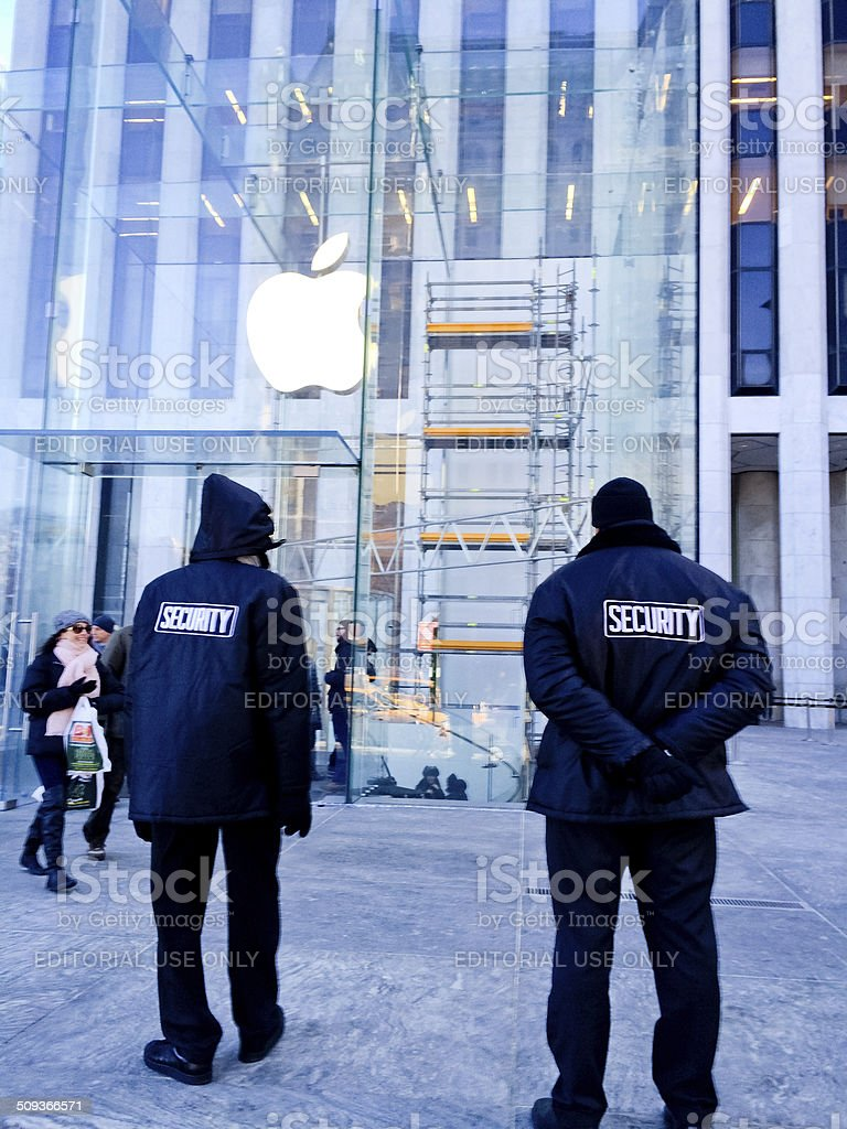 Security and Apple Store with broken glass, 5th Avenue, NY stock photo