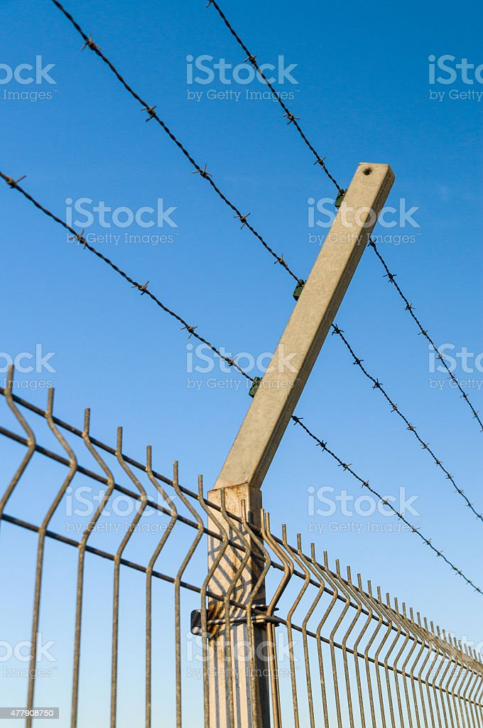Security Barbed Wire Fence Against Blue Sky Stock Photo & More ...