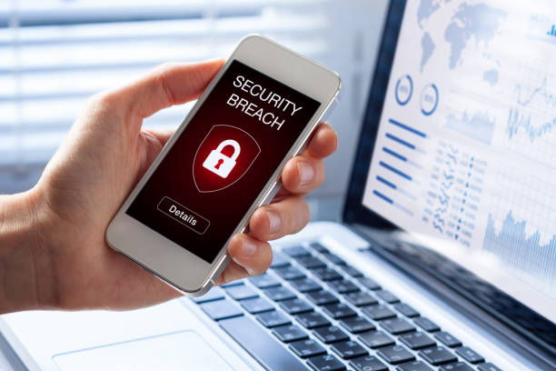 Security breach, smartphone screen, infected by internet virus, cyberattack hacking Security breach warning on smartphone screen, device infected by internet virus or malware after cyberattack by hacker, fraud alert with red padlock icon computer crime stock pictures, royalty-free photos & images
