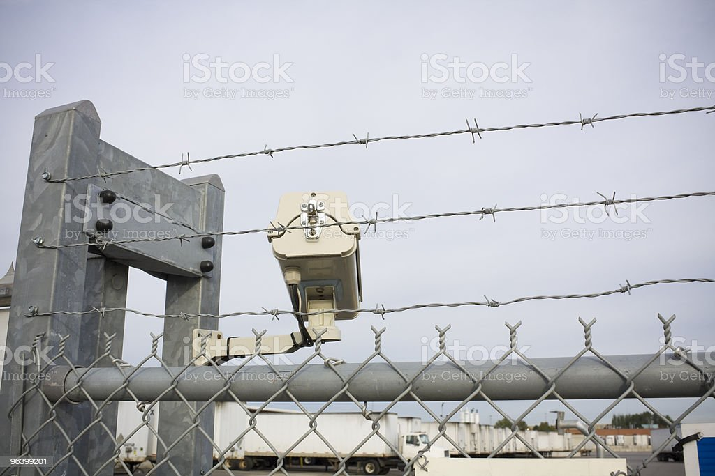 Security cam overlooking truck yard - Royalty-free Barbed Wire Stock Photo