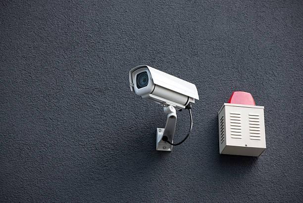 Telecamera di sicurezza sulla parete - foto stock