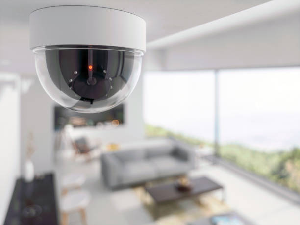 beveiligings camera in de woonkamer - bewakingscamera stockfoto's en -beelden