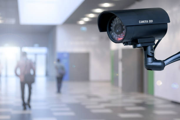 security camera in the corporation - security system stock photos and pictures