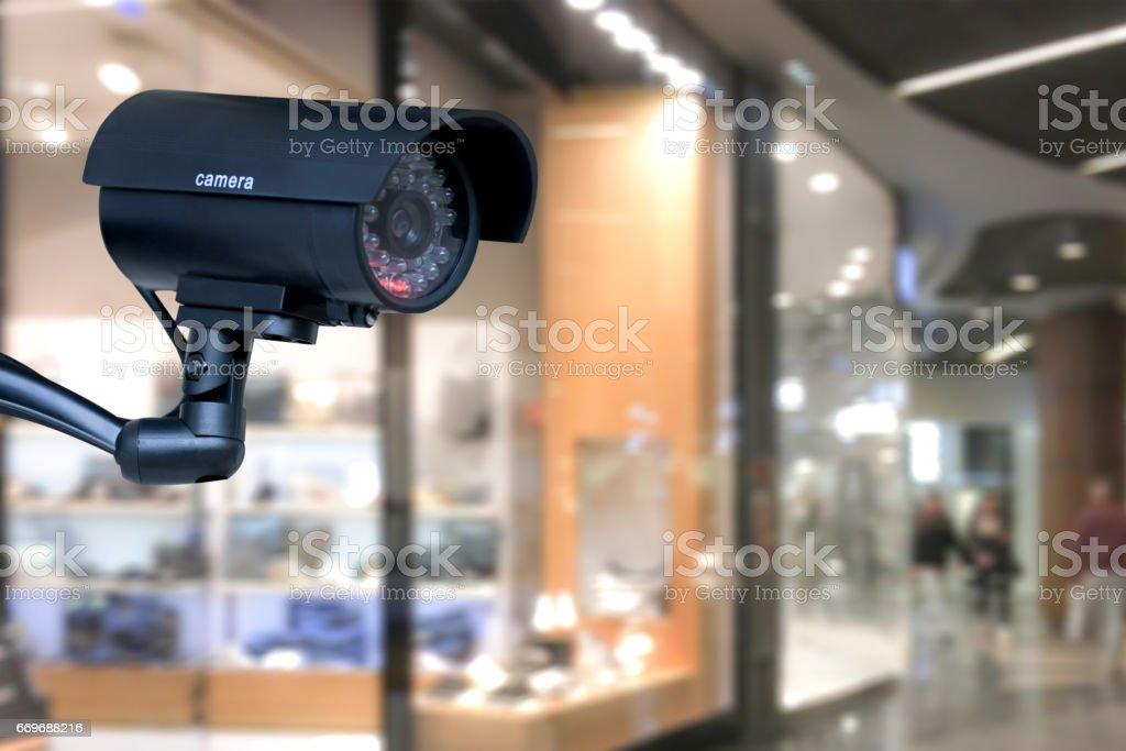 Bewakingscamera in het winkelcentrum foto