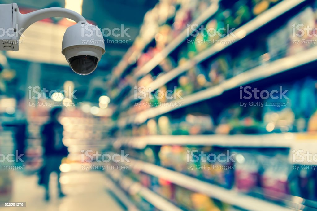 Security camera monitoring on the Abstract blurred photo of store in department store bokeh background, business shopping concept stock photo