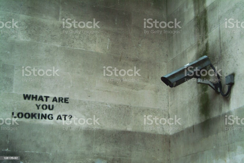 Security Camera Mounted on Wall with Graffiti royalty-free stock photo