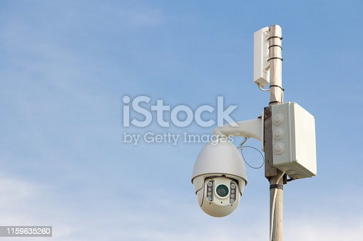istock Security Camera on a blue sky background. 1159635260