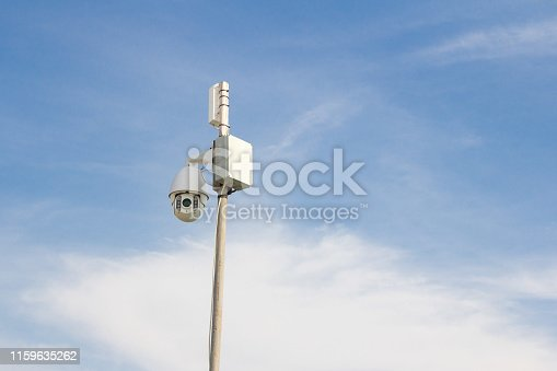 istock Security Camera on a blue sky background. 1159635262