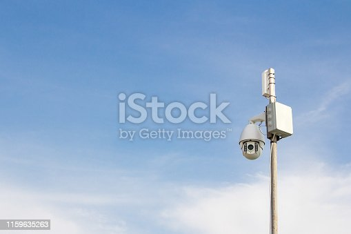istock Security Camera on a blue sky background. 1159635263