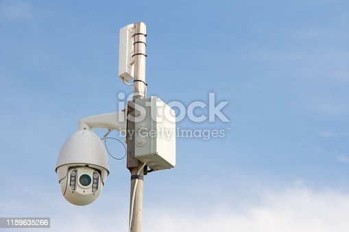 istock Security Camera on a blue sky background. 1159635266