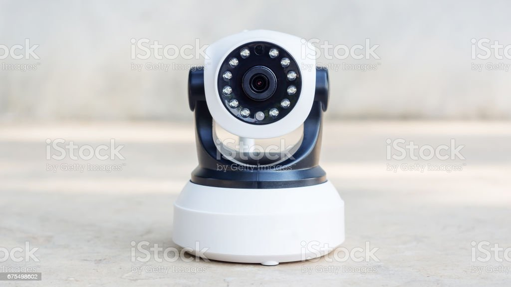 Security camera on a gray background. stock photo