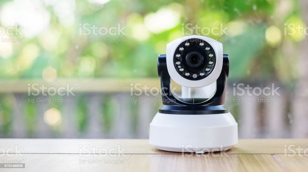 Security camera on a wooden table. stock photo