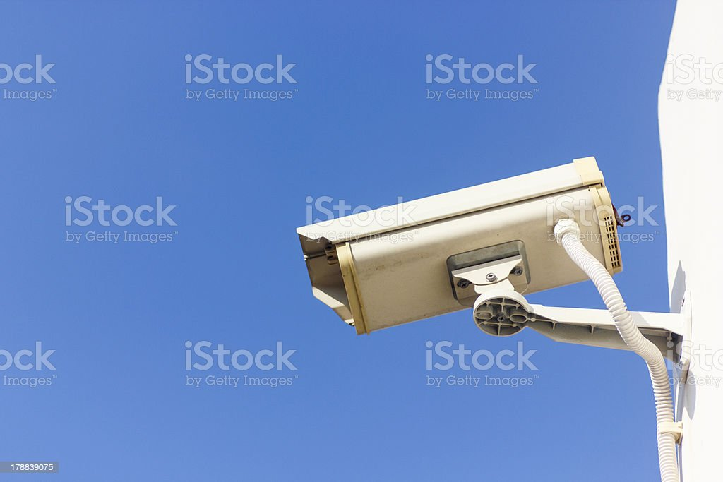 Security camera on blue sky background royalty-free stock photo