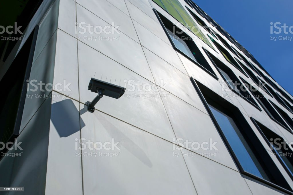 security camera on modern building stock photo