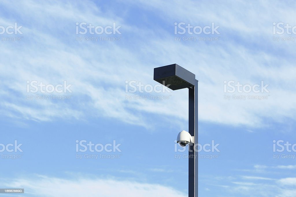 Rock Camera Surveillance : Security camera on outdoor light pole stock photo & more pictures of