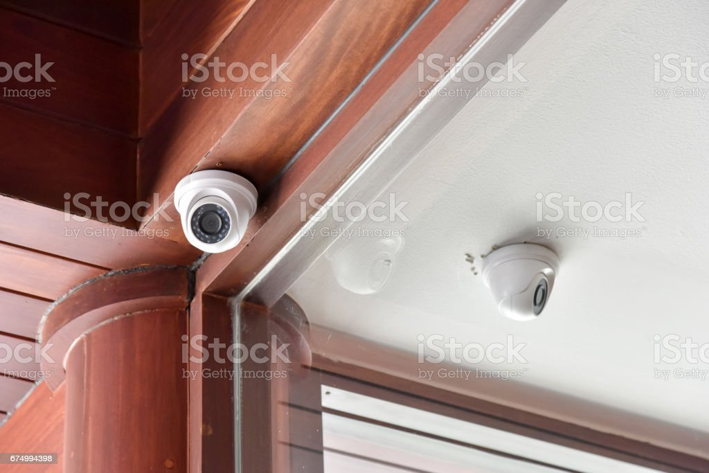 security camera on the ceiling stock photo