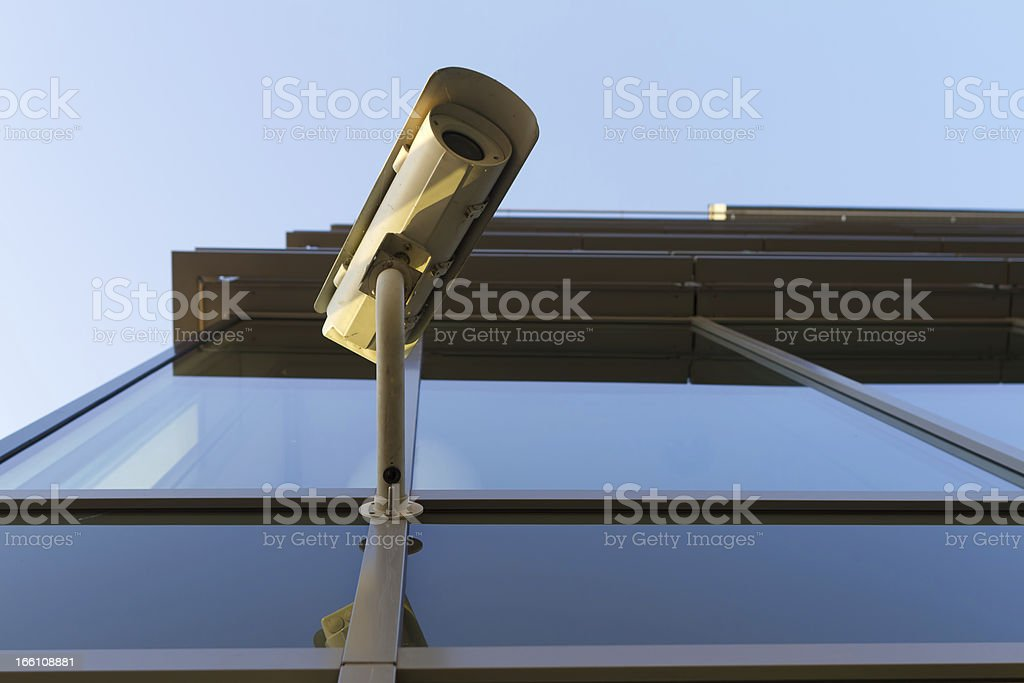 Security camera on the glass building royalty-free stock photo