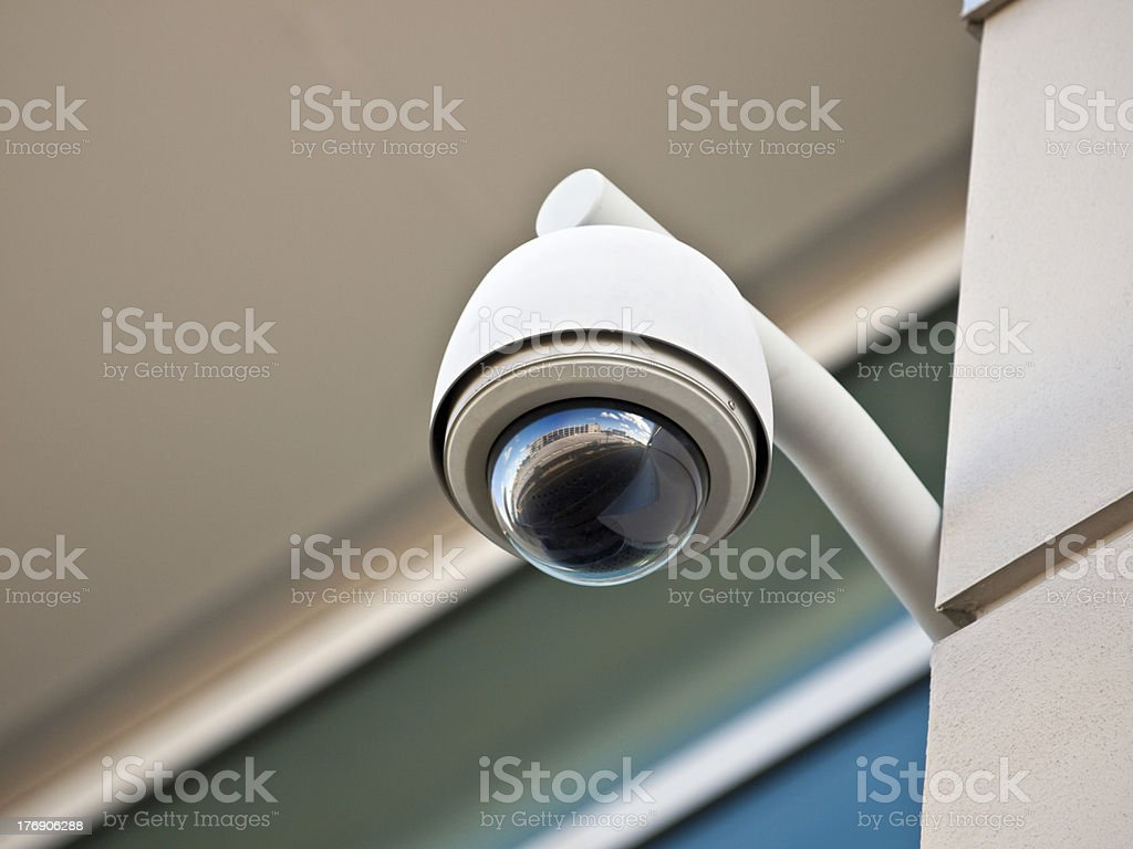 Security Camera High tech overhead security camera at a government owned building. Above Stock Photo