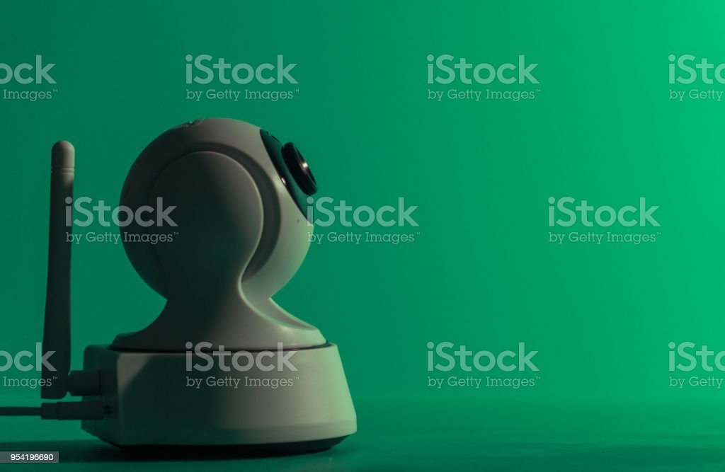 Security camera. The security camera turns the camera in different directions stock photo