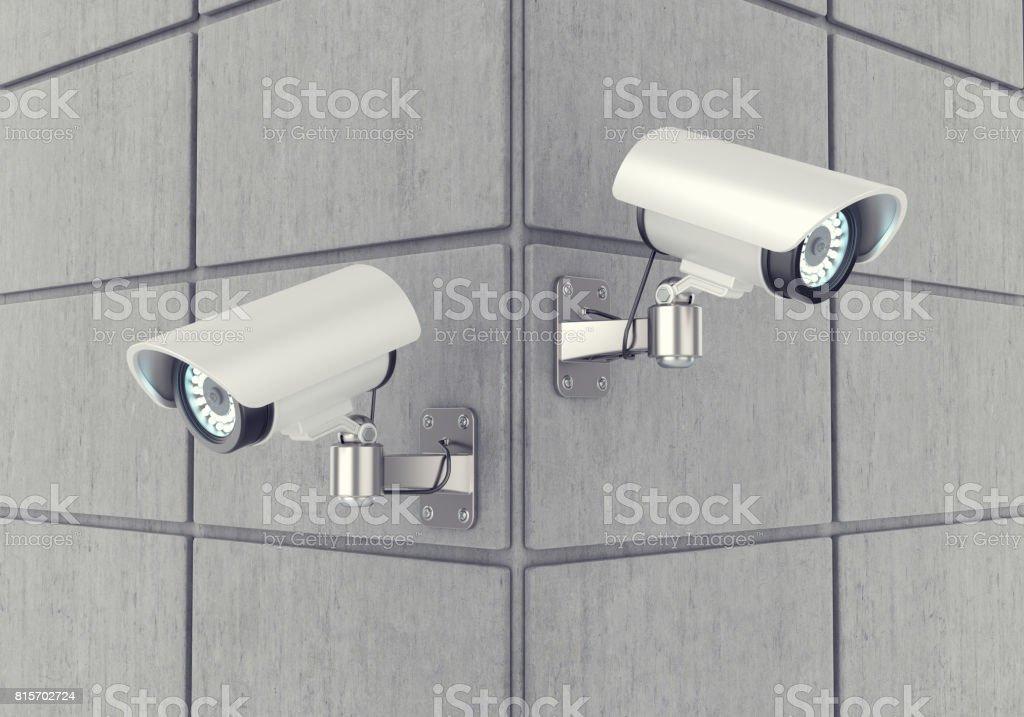 Bewakingscamera's op een stenen muur foto