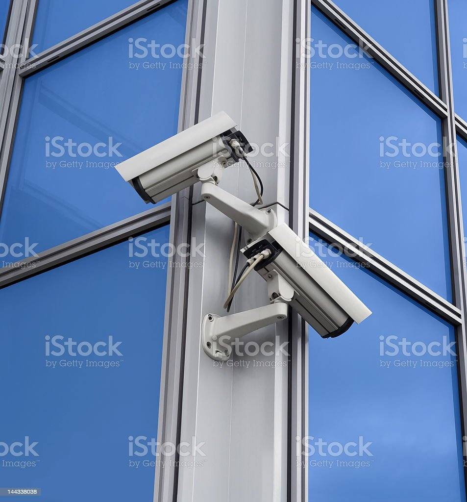 Security cameras on the building corner royalty-free stock photo