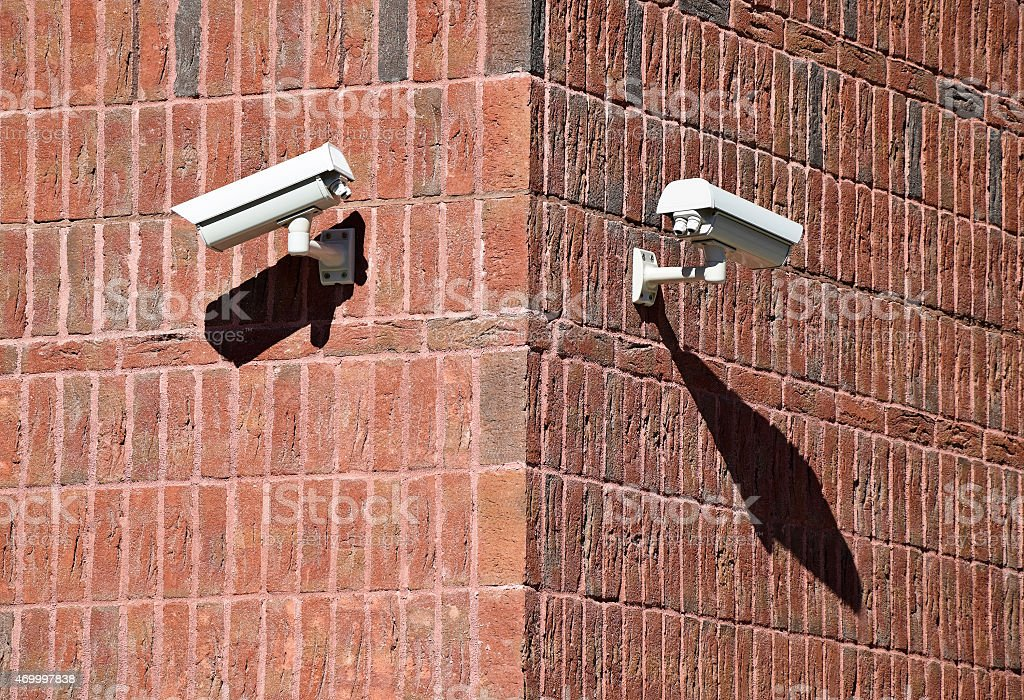 Security cameras on the wall of an office building stock photo