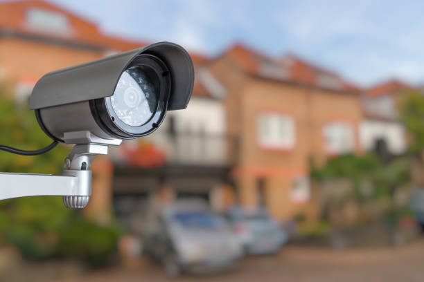 Security CCTV camera is monitoring home. Surveillance and safety concept. Security CCTV camera is monitoring home. Surveillance and safety concept. military private stock pictures, royalty-free photos & images