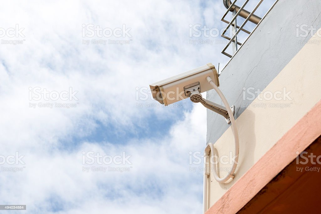 Security CCTV camera on concrete wall stock photo