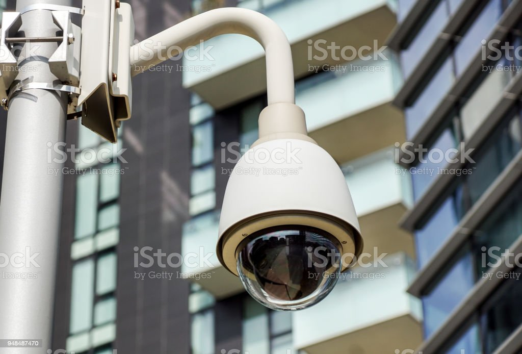 Security CCTV camera or surveillance system in office building - foto stock