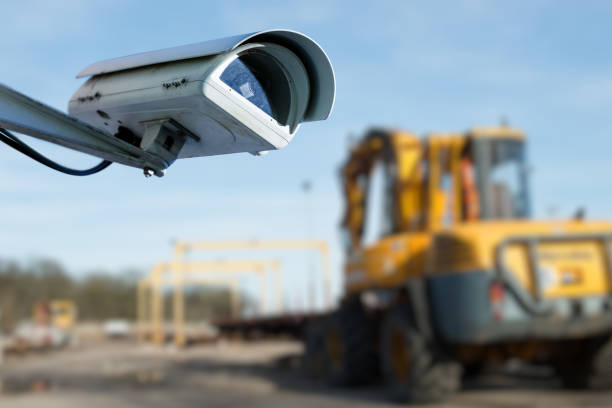 security CCTV camera or surveillance system with industrial site on blurry background stock photo