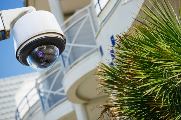 security cctv camera or surveillance system with modern luxury residence on blurry background - big brother orwellian concept stock pictures, royalty-free photos & images