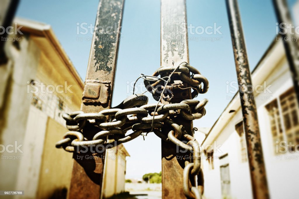 Security: chained and locked factory gate stock photo