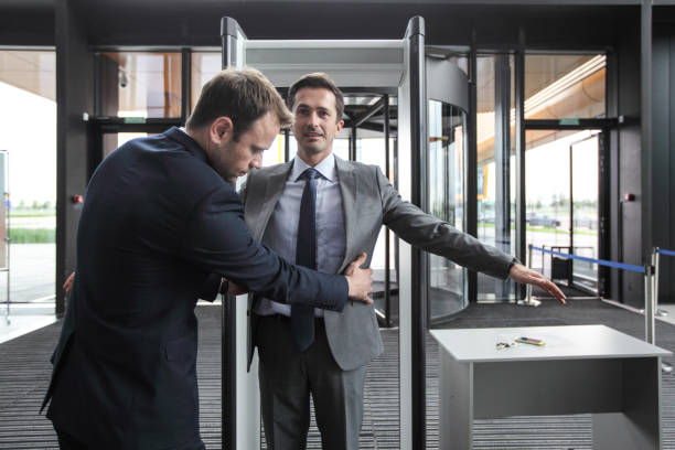 Security check businessman Security man check businessman at entrance in office building or airport security staff stock pictures, royalty-free photos & images