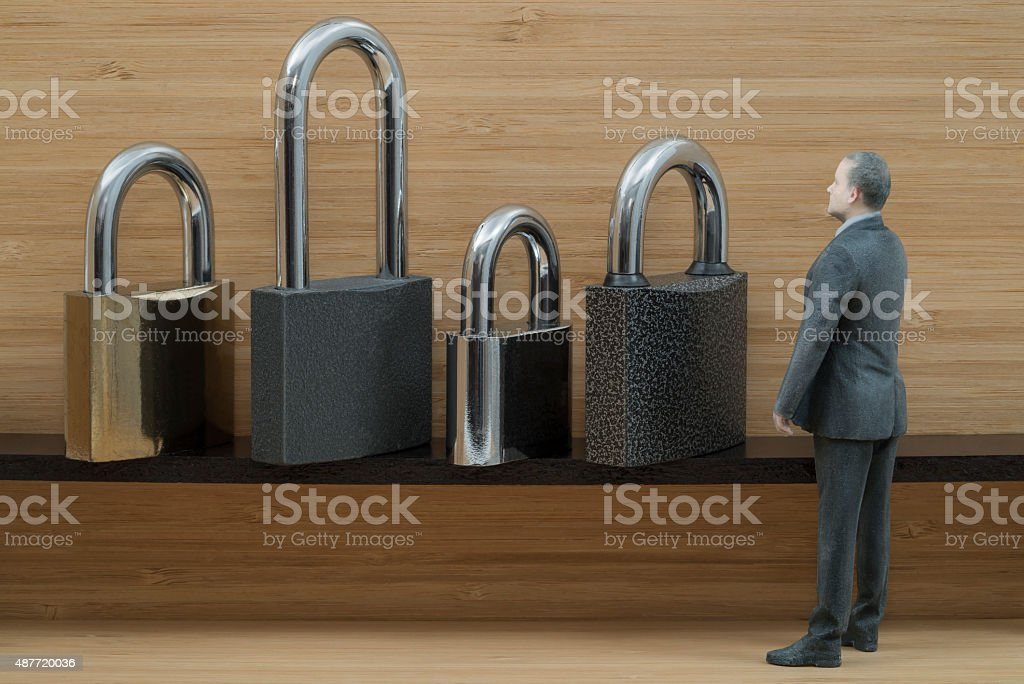 Security Concept: Businessman Action Figure with Padlocks royalty-free stock photo