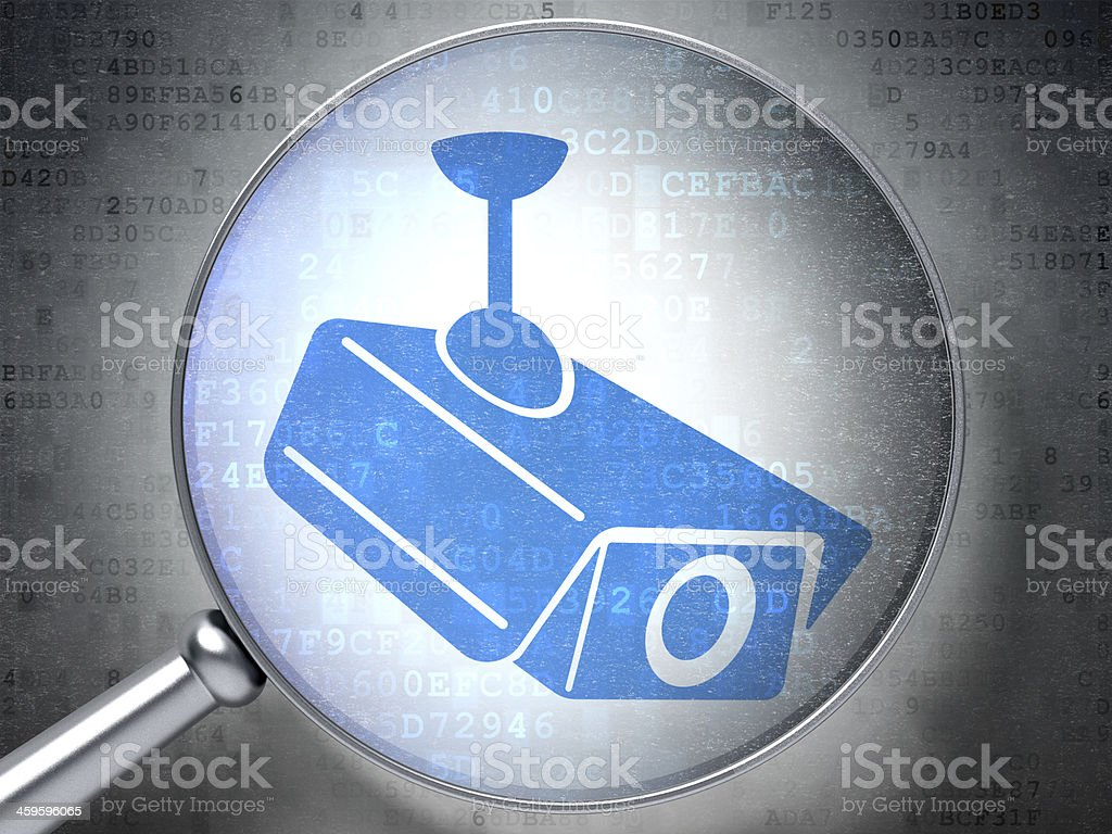 Security concept:  Cctv Camera with optical glass on digital bac stock photo