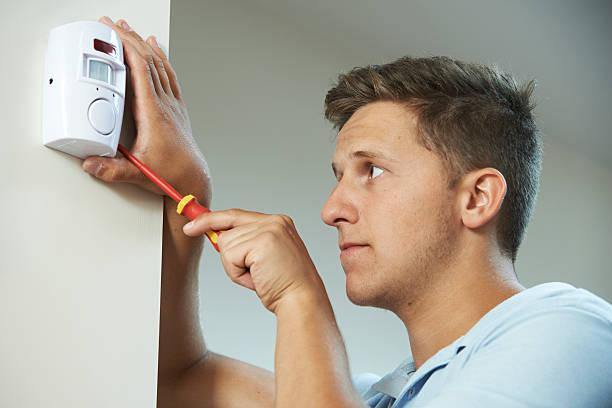 Sicherheit Consultant geschnittene Alarmanlage Sensor im Zimmer – Foto